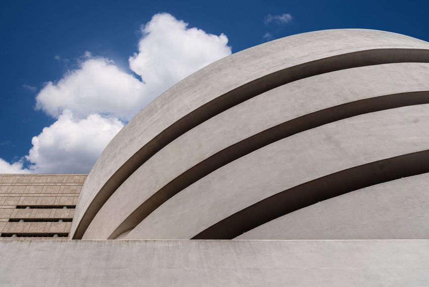 Solomon R. Guggenheim Museum in New York Architecture Day Manhattan NYC NYC Street Photography America American Architecture Solomon R. Guggenheim Museum Museum Frank Lloyd Wright Frank Lloyd Wright Architecture Guggenheim Guggenheimmuseum Guggenheim Nyc Travel Travel Destinations Tourism Tourist Attraction  Built Structure Cloud - Sky Sky Building Exterior Nature Low Angle View No People Sunlight Outdoors Building Pattern Modern Curve City Wall Shadow