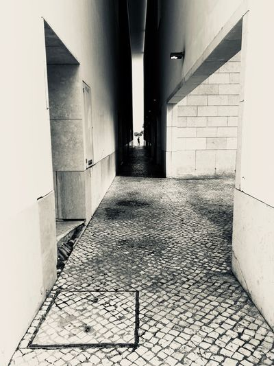 Architecture The Way Forward Built Structure Direction Building Arcade Wall - Building Feature No People Footpath Flooring Corridor Building Exterior Day Empty Wall Diminishing Perspective Outdoors Cobblestone Absence Long Paving Stone Alley Tiled Floor