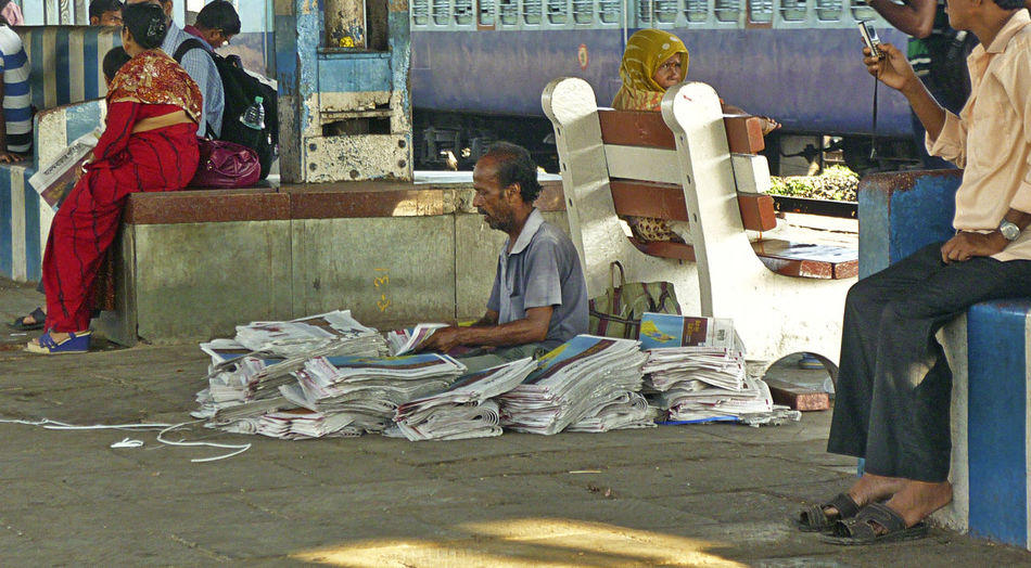 Aaj ki taza khabar (Today's fresh news) Morning Sunlight Streetphotography Street Station Newspaper Selling People Fresh News Railway Station Platform Railway Platform Oldman Crowded Business