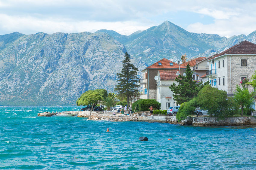 Beautiful coastline of Kotor bay in Montenegro Architecture Balkan Bohemian Kotor Bay Tranquility Travel Vacations Adriatic Sea Architecture Building Exterior Built Structure Culture History House Kotor Kotor, Montenegro Luxury Yacht Charter Montenegro Mountain Sea Travel Destinations Water Waterfront Yacht Yacht Charter Destination