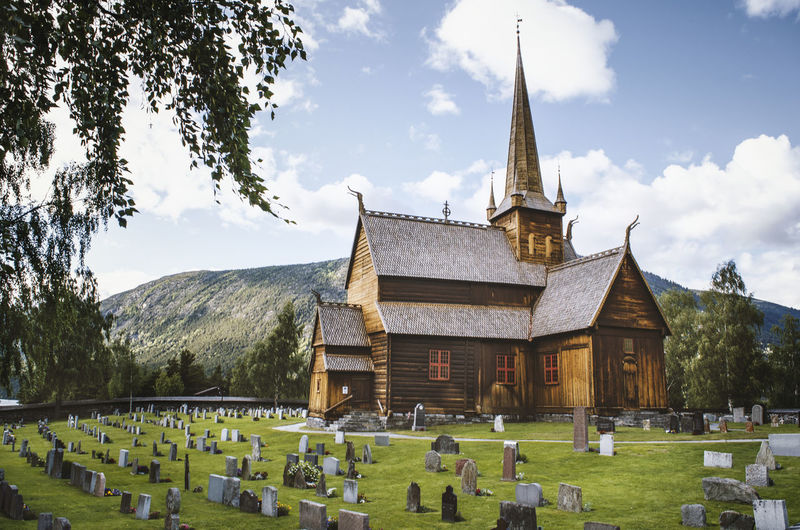 Stave Church in Lom, Norway Church Historical Building Lom Norway Norway Norway🇳🇴 Sightseeing Architecture Belief Building Building Exterior Built Structure Cemetery Churches Cloud - Sky Day Grass Grave Graveyard History Nature No People Outdoors Place Of Worship Plant Religion Sky Spire  Spirituality Stave Church The Past Travel Destinations Tree Wooden House