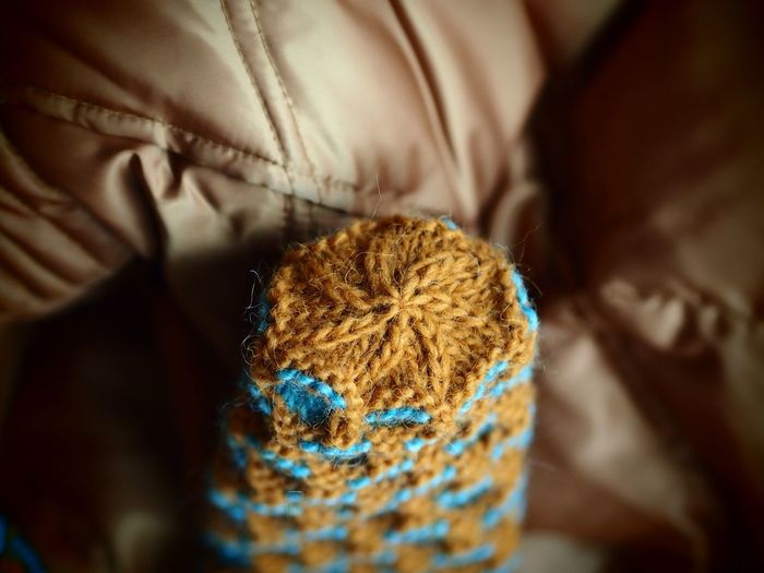 Handknit mitten Geometric Shape Geometry Copper Color Handknit Handmade Icelandic Wool EyeEm Selects Indoors  Selective Focus Close-up Textile No People Pattern Clothing Wool Focus On Foreground Softness