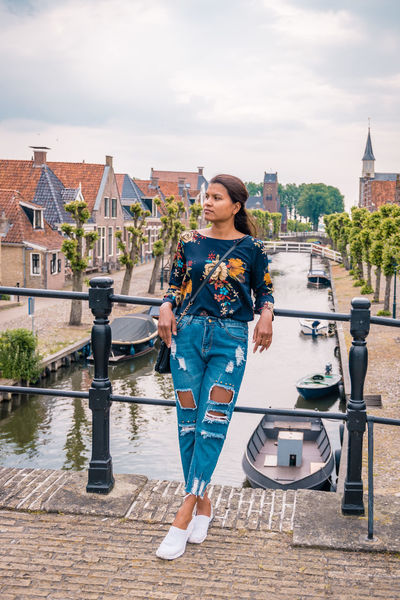 Netherlands Architecture Building Building Exterior Built Structure Casual Clothing City Day Dutch Freisland Friesland Town Front View Full Length Leisure Activity Lifestyles Nature One Person Outdoors Portrait Real People Sky Sloterdijk Smiling Standing Town Young Adult