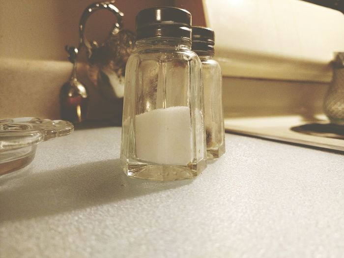 Close-up of salt shaker on table