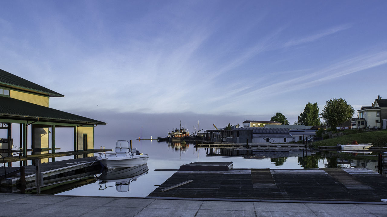 water, built structure, architecture, sky, building exterior, nautical vessel, outdoors, no people, tranquility, day, travel destinations, nature, harbor