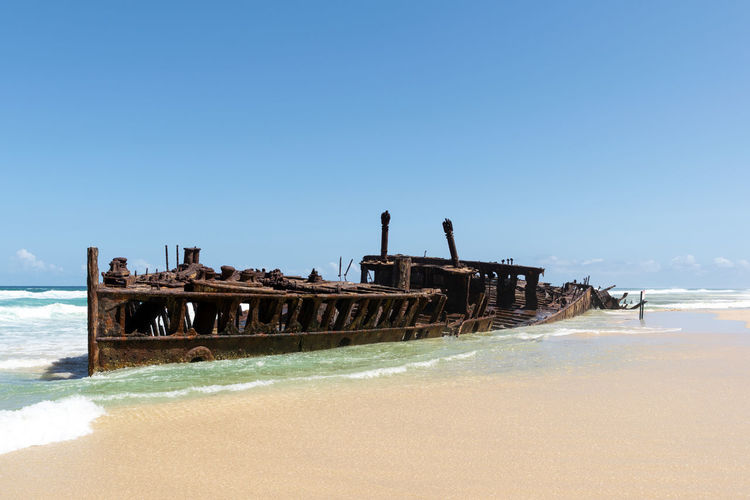 View of shipwreck on beach
