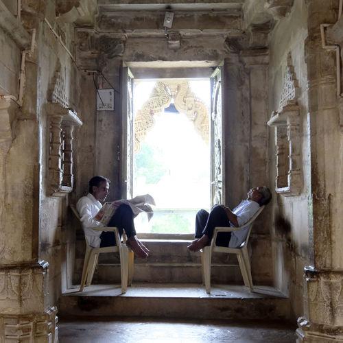 People sitting in corridor of building