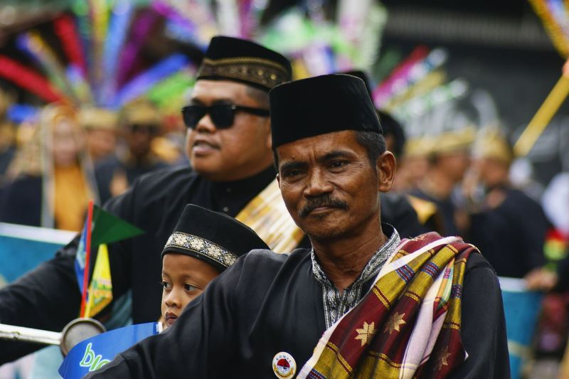 Bintan Carnival Traditional Culture Culture Cultural Heritage Cultures Culture Of Indonesia Culture And Tradition Togetherness Portrait Arts Culture And Entertainment Headwear Men Looking At Camera Mid Adult Close-up Festival Goer Entertainment Event Live Event Atmosphere