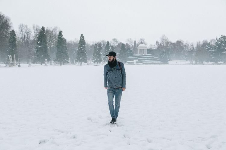 Full length of man walking on snow