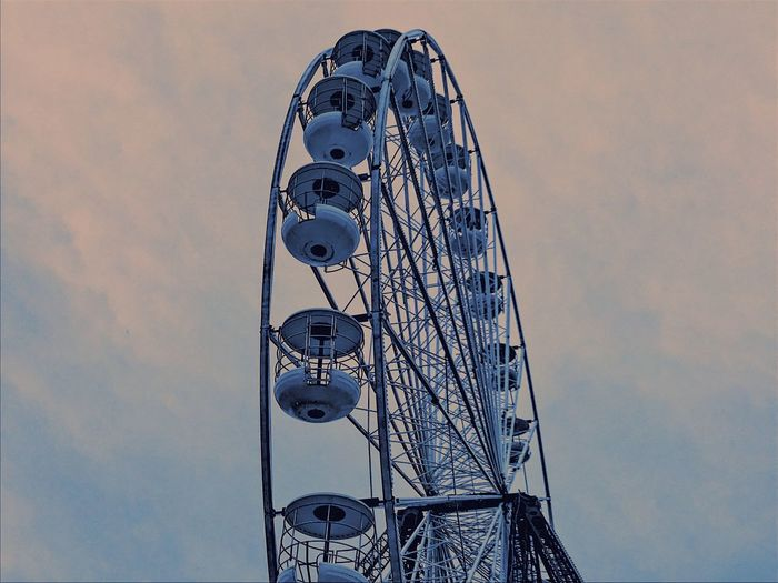 Meet me at the fairground Amusement Park Low Angle View Arts Culture And Entertainment No People Sky Day Outdoors Built Structure Ferris Wheel Amusement Park Ride Architecture Nature The Creative - 2018 EyeEm Awards