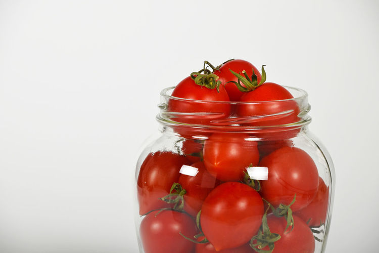 Red small cherry tomatoes in glass jar ready for conservation over white background Agriculture Cherry Tomatoes Cherrytomatoes Close-up Conservation Conserve Food Fresh Freshness Glass Jar Jar Organic Pickle Pickles Preparation  Preparing Preservation Preserve Red Ripe Season  Tomatoes White Background