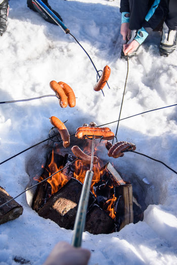 Low angle view of person preparing food in winter
