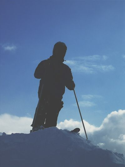 Low Angle View Of Man Snowboarding On Snowcapped Mountains