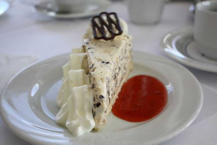 Cake Close-up Cream Day Dessert Food Food And Drink Freshness Horizontal Indoors  Indulgence No People Plate Ready-to-eat Serving Size Sweet Sweet Food Stracciatella Stracciatella Pie Strawberry Sauce