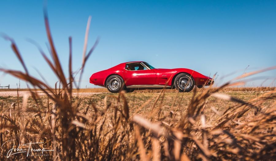 EyeEm Selects Mode Of Transportation Transportation Red Land Plant Car Motor Vehicle Land Vehicle Landscape Clear Sky Nature Sunlight Rural Scene Sky