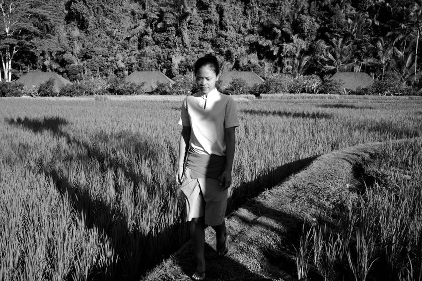 ubud is a mood Woman Walking Streetphotography Strideby Street Photography Rice Paddy Rice Field Lifestyles Portrait Of A Woman Blackandwhite Everybodystreet Harsh Light Bali B&w Street Photography Asian Girl Asian Beauty Sunlight Travel Photography Tourist Destination Wanderlust B&W Portrait Fujifilm_xseries One Person Beauty In Nature Outdoors