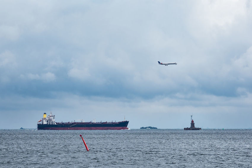 Vessel, airplane and lighthouse on the Baltic Sea. Baltic Sea Denmark Lighthouse Airplane Architecture Beauty In Nature Cloud - Sky Cobenhagen Day Flying Horizon Over Water Kopenhagen Mode Of Transport Nature Nautical Vessel No People Outdoors Sea Ship Sky Transportation Vessel Water Waterfront