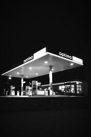 Gas station Blackandwhite EyeEm Best Shots Western Script Text Communication Night Transportation Illuminated Airport Fuel Pump Architecture