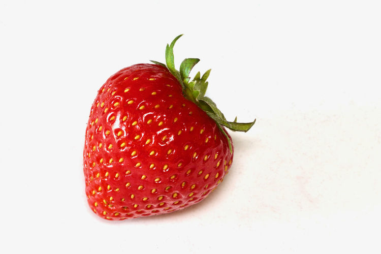 Close-up of strawberries against white background