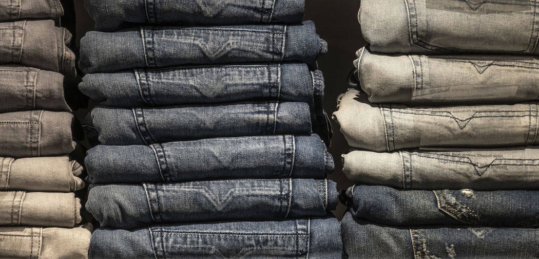 Closeup shot of stack of folded jeans