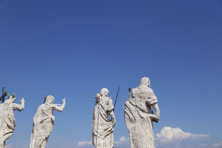 Statues on st peter basilica against sky