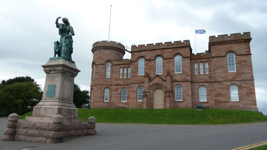Flora MacDonald statue in front of Inverness castle Bronze Flag Flora MacDonald Green Color Highlands Inverness Patina Scotland Statue