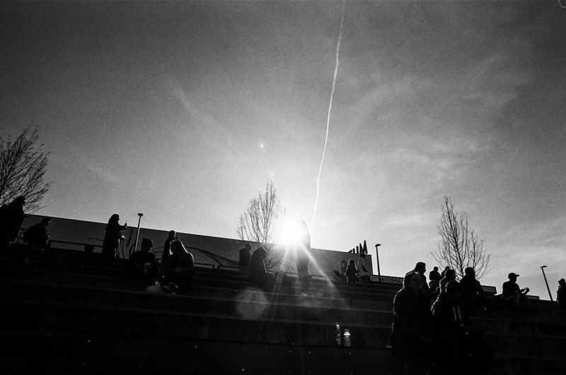 ANALOG; Rollei RPX 100 The Week on EyeEm Light And Shadow Capture The Moment Film Photography Rollei Analogue Photography Nikonphotography Street Photography Monochrome Black And White Bnw Spring Filmisnotdead Grain Sky Group Of People Real People Nature Crowd Men Sunlight Architecture Large Group Of People Sunbeam Silhouette Lifestyles Leisure Activity Lens Flare Day Sun Group Staircase Women Outdoors Vapor Trail Bright