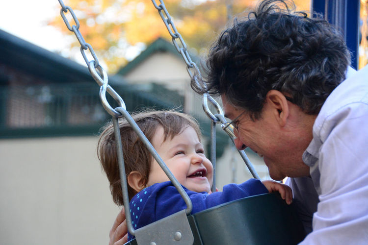 Father by and daughter on swing