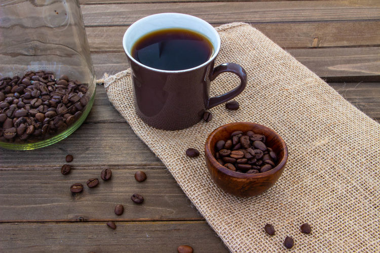 Brown Caffeine Coffee Coffee - Drink Coffee Bean Coffee Cup Cup Drink Food And Drink Freshness Mug Refreshment Roasted Coffee Bean Still Life Table