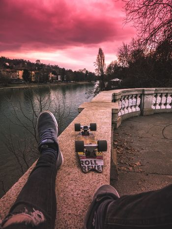 Tranquillity Tranquillity Calm Skateboarding Turin Human Leg Personal Perspective Low Section Human Body Part One Person Water Tree River Shoe Sunset Cloud - Sky Outdoors Real People Nature Sky Close-up Human Hand Retaining Wall Day Men