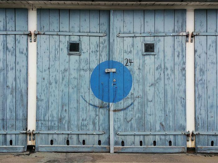 Closed Blue Door Of Garage