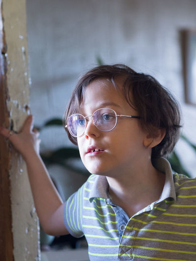 Kid Boy Standing In Doorway Concerned Elementary Age Eyeglasses  Headshot Portrait Close-up Children Preschooler Caucasian Head And Shoulders Glasses Pensive Thinking Thoughtful The Portraitist - 2019 EyeEm Awards