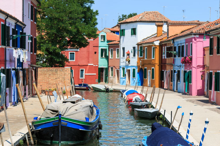 Burano's Colored Houses, Venice Architecture Boat Built Structure Burano, Italy Canal Colored Day Gondola Houses Italy Mode Of Transport Nature Nautical Vessel Outdoors Residential Building Rippled Sky Tourism Town Traditional Houses Transportation Travel Destinations Venice, Italy Water