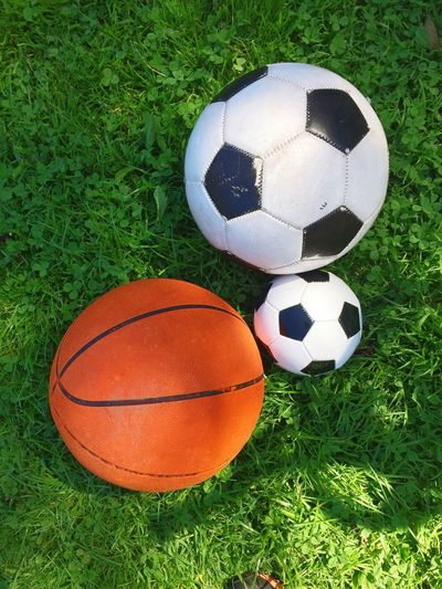 Soccer and basketballs on field
