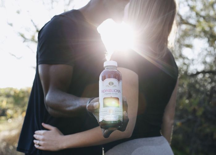 Kombucha and my love is all I need 🙏🏼😌✨ Married Bottle Lens Flare One Person Holding Outdoors Real People Leisure Activity Sunlight Lifestyles Young Women Human Hand Young Adult People Nature Day Women Close-up