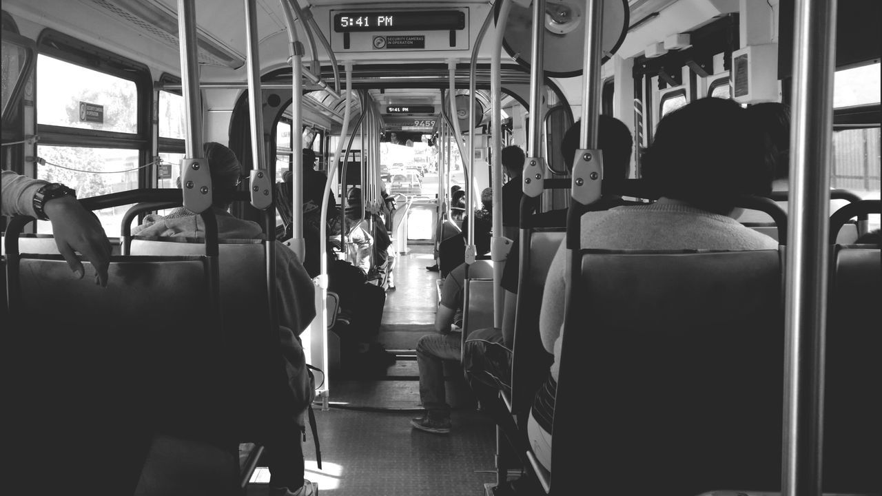 vehicle interior, transportation, vehicle seat, public transportation, mode of transport, train - vehicle, sitting, real people, medium group of people, indoors, bus, subway train, men, women, commuter train, day, adult, people
