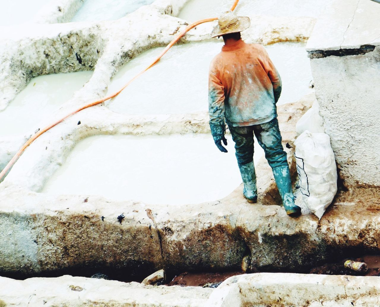 REAR VIEW OF MAN WORKING IN WINTER