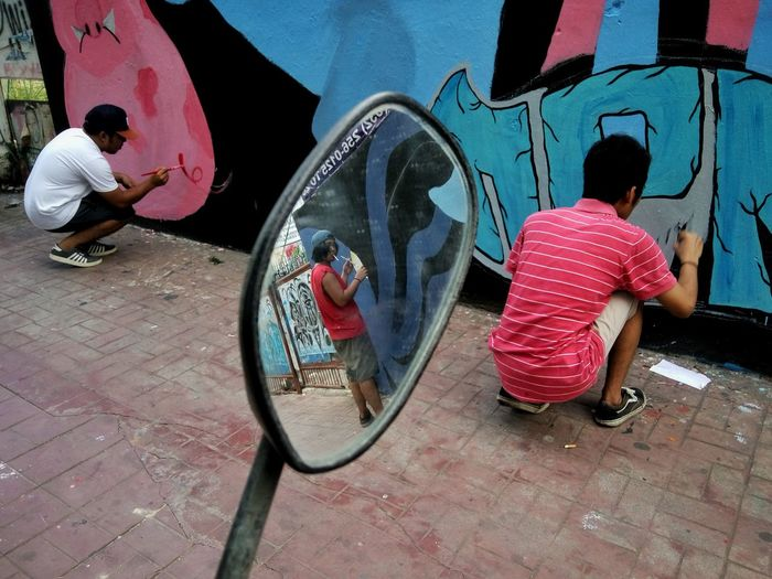 Full Length Real People Rear View Outdoors Lifestyles Men Day People Only Men Art Is Everywhere Eyeem Philippines Mural Painting Mirror Reflection Street