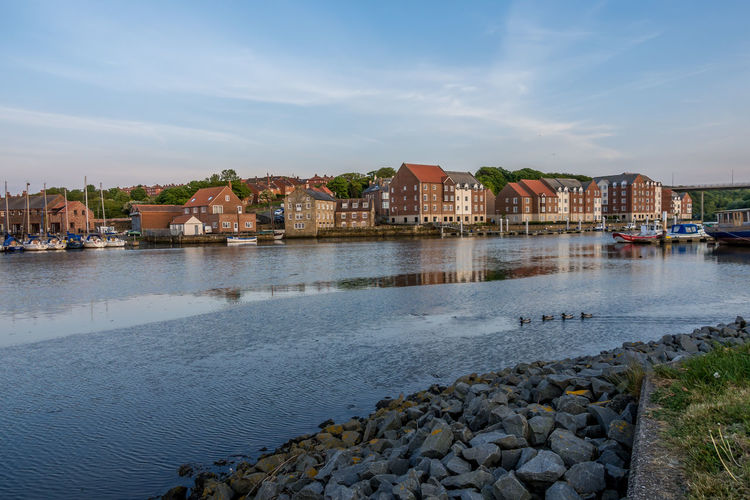 Whitby Whitby Harbour Whitby North Yorkshire Whitby View Yorkshire Coast Yorkshire North Yorkshire Water No People Cloud - Sky Outdoors River Architecture Houses Riverside Riverside View Building Rock - Object Rock Built Structure Residential District Day Sky Dusk