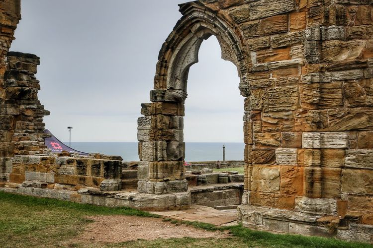 Whitby Whitby Whitby Abbey Architecture History The Past Built Structure Sky Building Exterior Arch Ancient Travel Destinations Old Day Old Ruin Nature Building Tourism Travel No People Religion Place Of Worship Belief Outdoors Architectural Column Ancient Civilization Stone Wall Archaeology