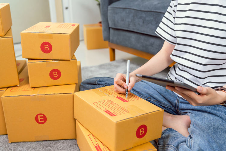 Full length of baby boy sitting in box
