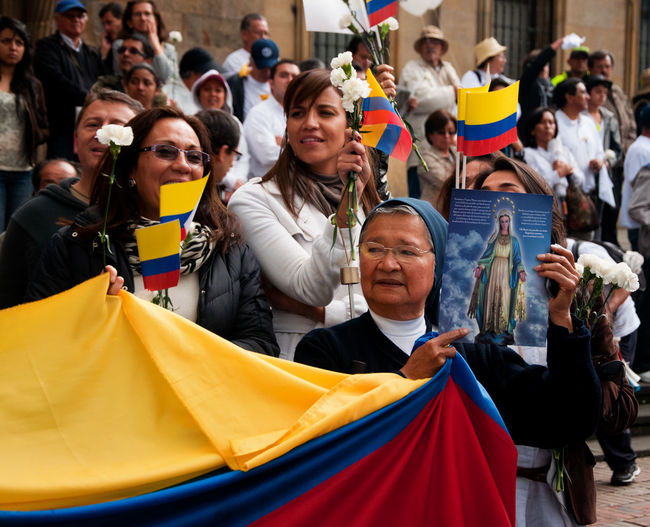 People line the streets of Bogota, Colombia to protest against the FARC on December 6, 2011 Activism Activist  America Anti Bogotá Cause Colombia Crowd Demonstrators Dissent Editorial  Farc Gather Group Of People March Message Movement Protest Rally Solidarity South Street Symbol