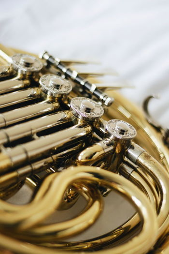 Close-Up Of Brass Instrument On Table