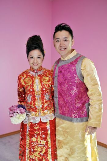 Weddings Around The World Canadian Chinese Wedding this young couple is wearing Chinese Tranditional Wedding Gown which make the wedding more meaningful.@ YYC