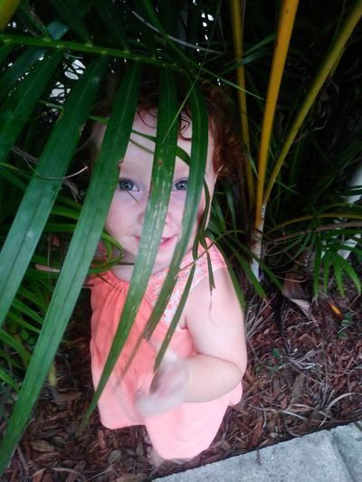 Outdoors Day Nature Close-up One Person Kids Of EyeEm Nature Child Blue Eyes EyeEm Selects Tropical Beauty Peeking Through Peeking Through The Trees Standing Mix Yourself A Good Time The Week On EyeEm EyeEm Ready   Inner Power This Is My Skin The Portraitist - 2018 EyeEm Awards