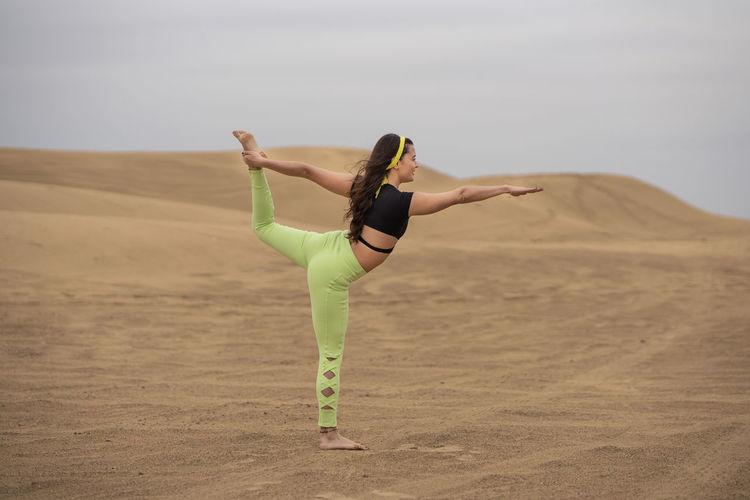 Full length of woman walking in desert