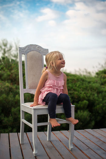 Chair Skyline Babygirl Blond Hair Casual Clothing Chair Child Childhood Childhood Memories Day Elementary Age Full Length Girls Leisure Activity Lifestyles Nature One Person Outdoors People Portrait Real People Sitting Sky Toddler  Young Adult
