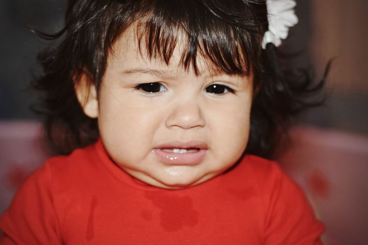 Close-Up Of Cute Baby Girl Crying At Home