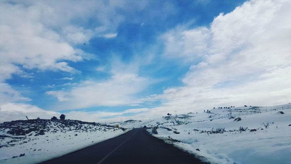 Road Snow Cloud - Sky Landscape Winter Sky Outdoors The Way Forward No People Nature Mountain Cold Temperature Scenics Transportation Travel Day Road Trip Beauty In Nature EyeEmNewHere Connected By Travel Lost In The Landscape Perspectives On Nature Shades Of Winter