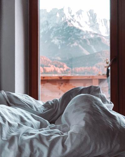 Duvet against window in bedroom home